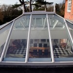Exterior view of timber double hipped roof lantern showing white aluminium capping