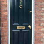 Victorian style town house front door with four raised and fielded panels and bolection moulding
